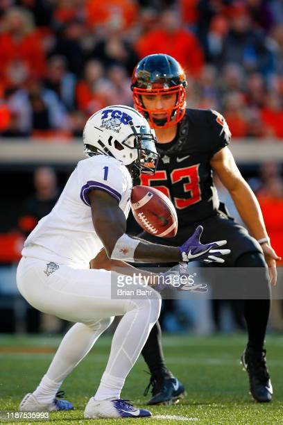 Jalen Reagor of the TCU Horned Frogs bobbles but catches a punt on a fair catch under the watchful eye of long snapper Matt Hembrough in the third...