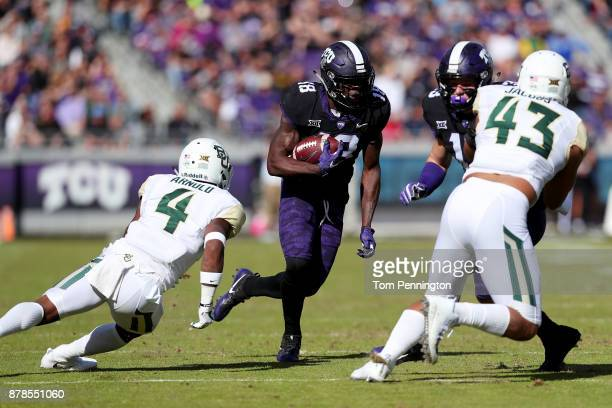 Jalen Reagor of the TCU Horned Frogs carries the ball against Grayland Arnold of the Baylor Bears and Jamie Jacobs of the Baylor Bears in the first...