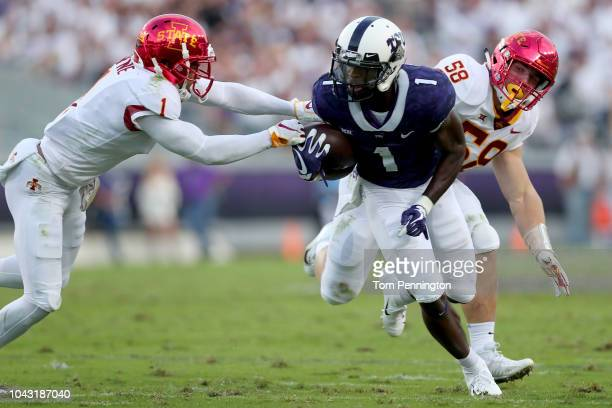 Jalen Reagor of the TCU Horned Frogs carries the ball against D'Andre Payne of the Iowa State Cyclones and Spencer Benton of the Iowa State Cyclones...
