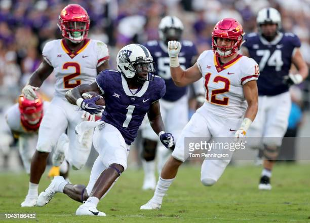 Jalen Reagor of the TCU Horned Frogs carries the ball against Willie Harvey of the Iowa State Cyclones and Greg Eisworth of the Iowa State Cyclones...