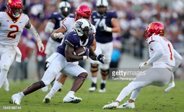 Jalen Reagor of the TCU Horned Frogs carries the ball against Willie Harvey of the Iowa State Cyclones Greg Eisworth of the Iowa State Cyclones and...