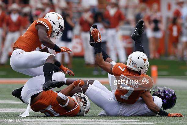 Jalen Reagor of the TCU Horned Frogs is tackled by Caden Sterns of the Texas Longhorns and PJ Locke III in the first half at Darrell K RoyalTexas...