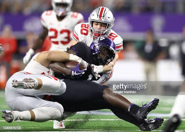 Jalen Reagor of the TCU Horned Frogs is tackled by Nick Bosa and Pete Werner of the Ohio State Buckeyes in the second quarter during The AdvoCare...