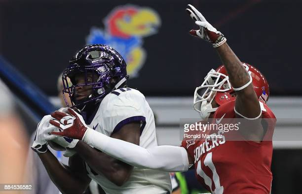 Jalen Reagor of the TCU Horned Frogs makes a touchdown pass reception against Parnell Motley of the Oklahoma Sooners in the second quarter during Big...