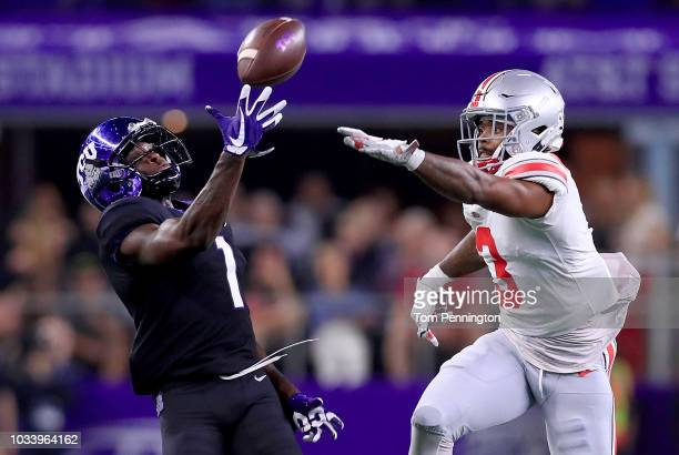 Jalen Reagor of the TCU Horned Frogs pulls in a pass against Damon Arnette Jr of the Ohio State Buckeyes in the first quarter during The AdvoCare...