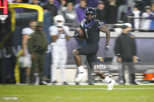 Jalen Reagor of the TCU Horned Frogs returns a punt for a touchdown against the West Virginia Mountaineers in the second half at Amon G Carter...
