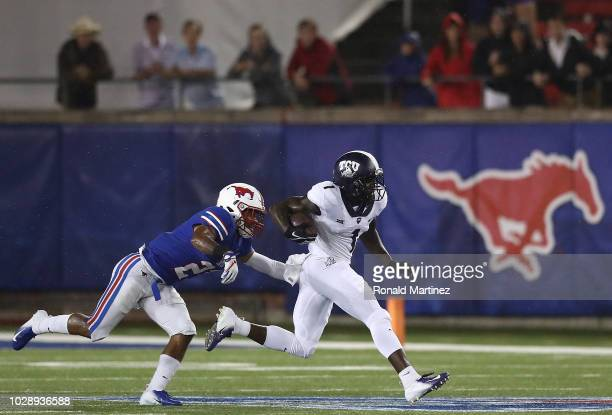 Jalen Reagor of the TCU Horned Frogs runs the ball against Cole Sterns of the Southern Methodist Mustangs at Gerald J Ford Stadium on September 7...