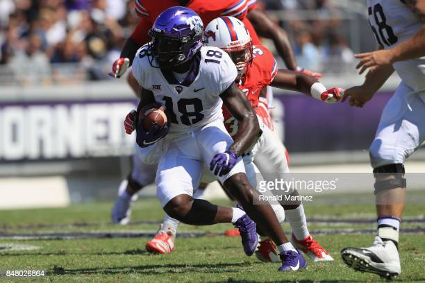 Jalen Reagor of the TCU Horned Frogs runs the ball against the Southern Methodist Mustangs in the first half at Amon G Carter Stadium on September 16...
