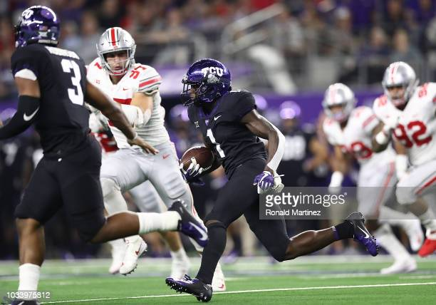 Jalen Reagor of the TCU Horned Frogs runs the ball against the Ohio State Buckeyes in the second quarter during The AdvoCare Showdown at ATT Stadium...