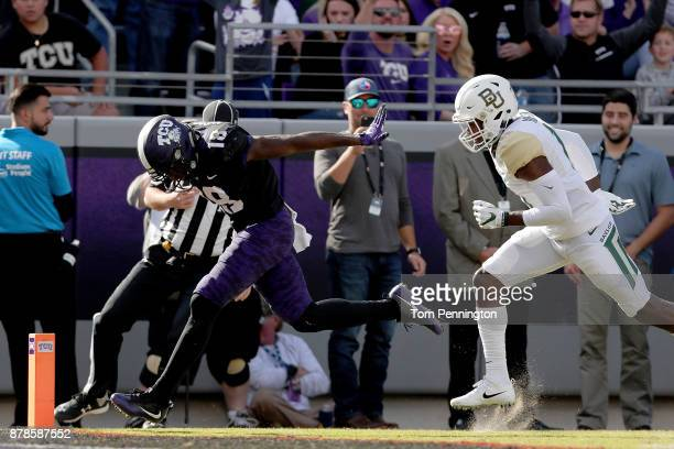 Jalen Reagor of the TCU Horned Frogs scored a touchdown against Jameson Houston of the Baylor Bears in the second half at Amon G Carter Stadium on...