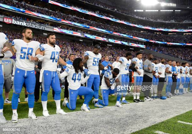 Jalen ReevesMaybin of the Detroit Lions and teammate Steve Longa take a knee during the national anthem before the game against the Minnesota Vikings...