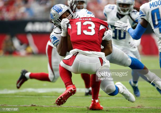 Jalen Reeves-Maybin of the Detroit Lions makes a tackle on Christian Kirk of the Arizona Cardinals during the first half of the NFL football game at...