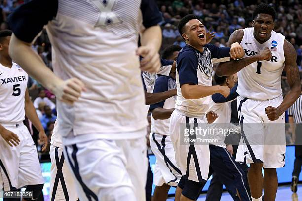 Jalen Reynolds of the Xavier Musketeers and teammates react as the first half ends against the Georgia State Panthers during the third round of the...
