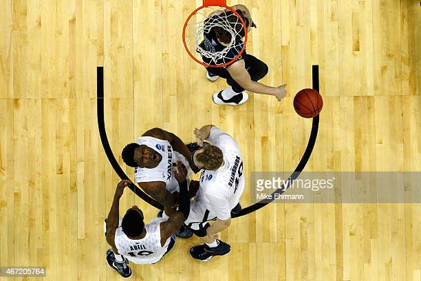 Jalen Reynolds of the Xavier Musketeers celebrates a defensive foul on the Georgia State Panthers with teammates Remy Abell and Matt Stainbrook in...