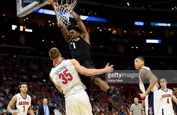 Jalen Reynolds of the Xavier Musketeers dunks the ball against Kaleb Tarczewski of the Arizona Wildcats in the second half during the West Regional...