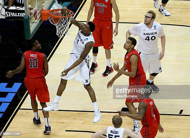 Jalen Reynolds of the Xavier Musketeers dunks the ball over Ladarius White of the Mississippi Rebels in the first half during the second round of the...