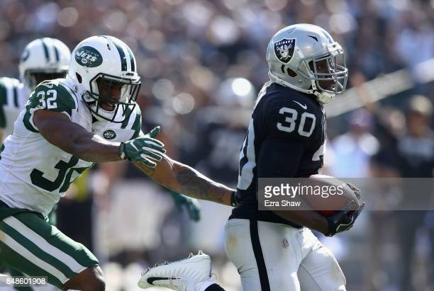 Jalen Richard of the Oakland Raiders breaks free from Juston Burris of the New York Jets on his way to scoring a touchdown at OaklandAlameda County...