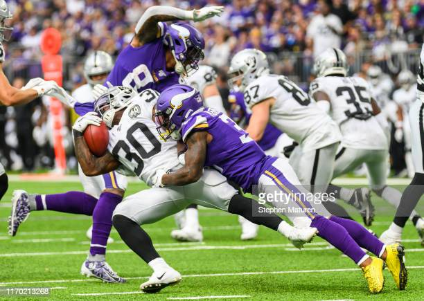 Jalen Richard of the Oakland Raiders is tackled by Ameer Abdullah of the Minnesota Vikings while carrying the ball in the second quarter of the game...