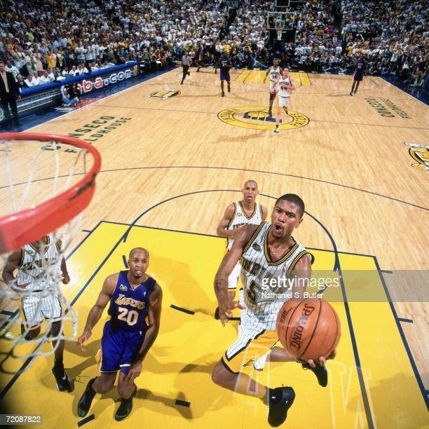 Jalen Rose of the Indiana Pacers attempts a layup against Brian Shaw of the Los Angeles Lakers during Game Three of the 2000 NBA Finals at Conseco...
