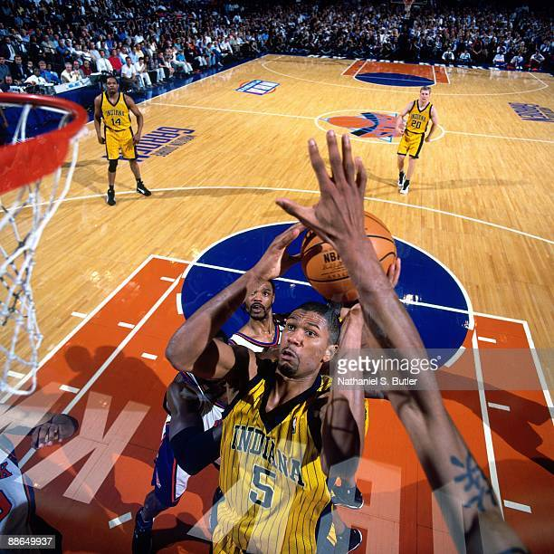 Jalen Rose of the Indiana Pacers goes up for a shot against the New York Knicks in Game Four of the Eastern Conference Finals during the 1999 NBA...
