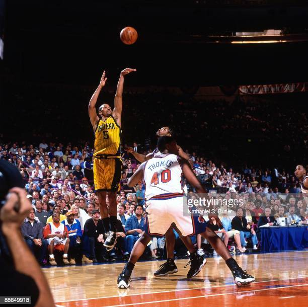 Jalen Rose of the Indiana Pacers shoots a jump shot over Kurt Thomas and Latrell Sprewell of the New York Knicks in Game Three of the Eastern...