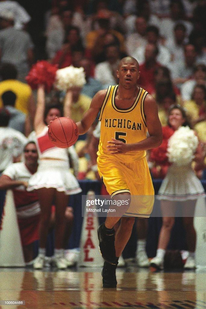 Jalen Rose #5 of the Michigan Wolverines dribbles against Coastal Carolina during a NCAA first round basketball game at the McKale Center on March 19, 1993 in Tuscon, Arizona..