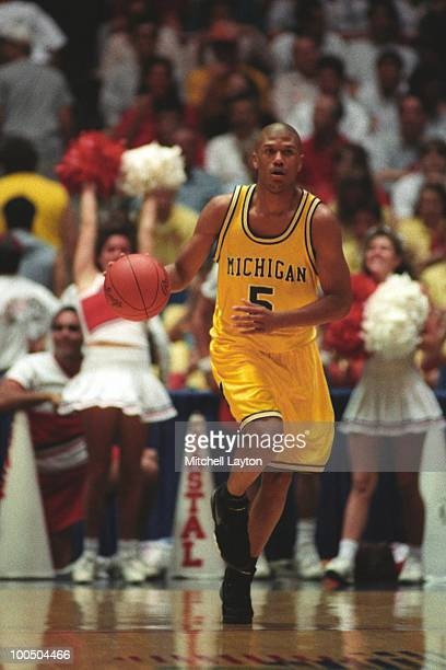 Jalen Rose of the Michigan Wolverines dribbles against Coastal Carolina during a NCAA first round basketball game at the McKale Center on March 19...