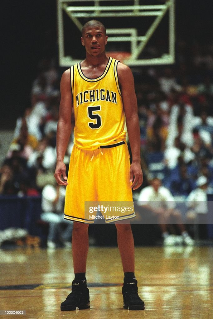 Jalen Rose #5 of the Michigan Wolverines looks on during a NCAA second round basketball game at the McKale Center on March 21, 1993 in Tuscon, Arizona..