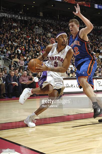 Jalen Rose of the Toronto Raptors drives baseline against David Lee of the New York Knicks on January 15 2006 at the Air Canada Centre in Toronto...
