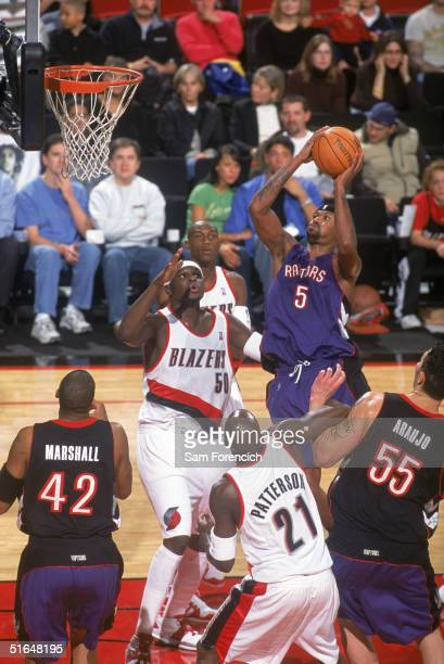 Jalen Rose of the Toronto Raptors goes to the basket against Zach Randolph of the Portland Trail Blazers during a preseason game at The Rose Garden...