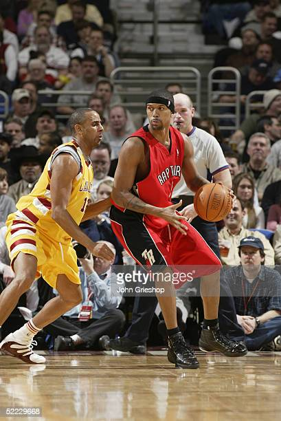 Jalen Rose of the Toronto Raptors moves the ball against Lucious Harris of the Cleveland Cavaliers during the game on February 8 2005 at Gund Arena...