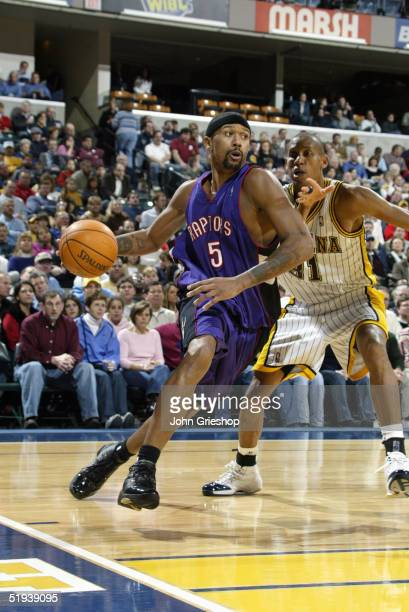 Jalen Rose of the Toronto Raptors moves the ball during the game against the Indiana Pacers on December 17, 2004 at Conseco Fieldhouse in...