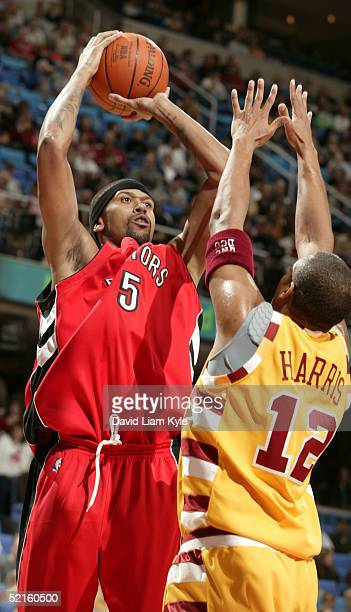 Jalen Rose of the Toronto Raptors shoots over Lucious Harris of the Cleveland Cavaliers on February 8 2005 at Gund Arena in Cleveland Ohio The Cavs...