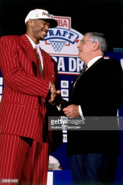 Jalen Rose poses with NBA Commissioner David Stern after being drafted by the Denver Nuggets in the first round of the 1994 NBA Draft NOTE TO USER...