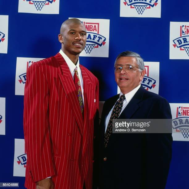Jalen Rose selected thirteenth overall by the Denver Nuggets in the 1994 NBA Draft poses with David Stern on June 29 1994 in Idianapolis Indiana NOTE...