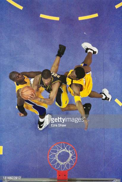 Jalen Rose, Small Forward, Shooting Guard and Point Guard for the Indiana Pacers drives to the basketball hoop as Kobe Bryant and Glen Rice attempt...