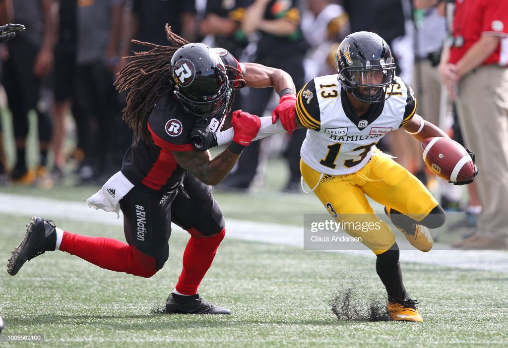 Jalen Saunders of the Hamilton Tiger-Cats tries to elude a tackle ... ba6cb6e80