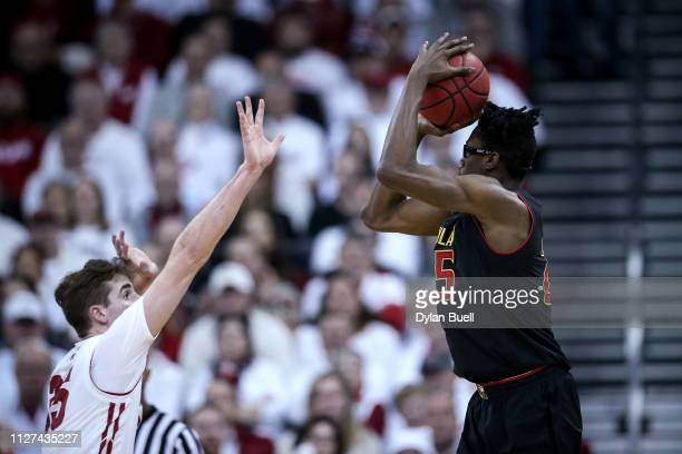 Jalen Smith of the Maryland Terrapins attempts a shot while being guarded by Nate Reuvers of the Wisconsin Badgers in the first half at the Kohl...