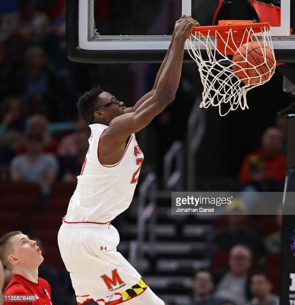 Jalen Smith of the Maryland Terrapins dunks over Thorir Thorbjarnarson of the Nebraska Cornhuskers at the United Center on March 14 2019 in Chicago...