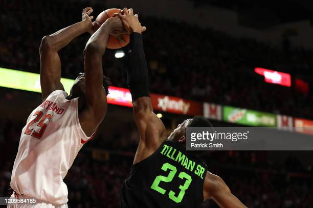 Jalen Smith of the Maryland Terrapins has his shot blocked by Xavier Tillman of the Michigan State Spartans during the second half at Xfinity Center...