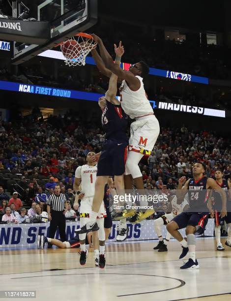 Jalen Smith of the Maryland Terrapins makes the slam dunk over Dylan Windler of the Belmont Bruins in the second half during the first round of the...