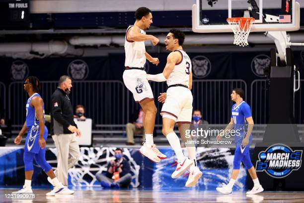 Jalen Suggs and Andrew Nembhard of the Gonzaga Bulldogs celebrate a basket against the Creighton Bluejays in the Sweet Sixteen round of the 2021 NCAA...