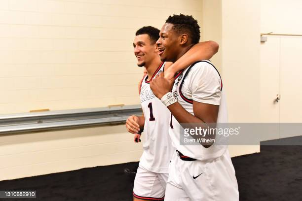 Jalen Suggs and Joel Ayayi of the Gonzaga Bulldogs walk back to the locker room after their ovetime win against the UCLA Bruins in the Final Four...