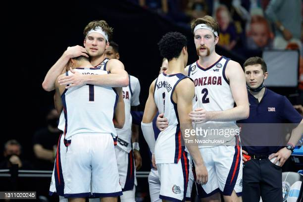 Jalen Suggs, Corey Kispert, Andrew Nembhard and Drew Timme of the Gonzaga Bulldogs react after losing the National Championship game of the 2021 NCAA...