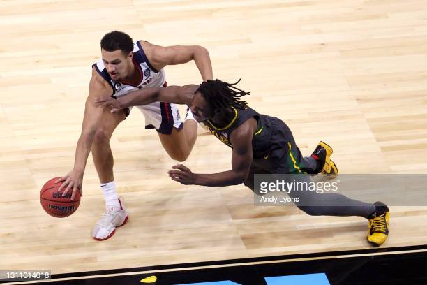 Jalen Suggs of the Gonzaga Bulldogs and Davion Mitchell of the Baylor Bears battle for a loose ball in the National Championship game of the 2021...