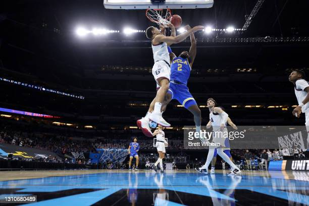 Jalen Suggs of the Gonzaga Bulldogs blocks a shot by Cody Riley of the UCLA Bruins in the Final Four semifinal game of the 2021 NCAA Men's Basketball...