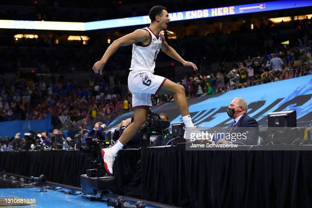 Jalen Suggs of the Gonzaga Bulldogs celebrates after making a game-winning, last-second, three-point shot in overtime against the UCLA Bruins in the...
