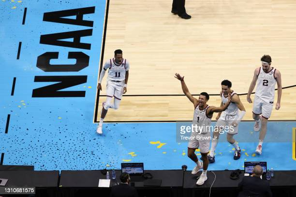 Jalen Suggs of the Gonzaga Bulldogs celebrates after making the game-winning, last-second, three-point shot in overtime against the UCLA Bruins in...