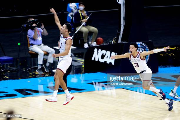 Jalen Suggs of the Gonzaga Bulldogs celebrates making a game-winning three point basket in overtime to defeat the UCLA Bruins 93-90 during the 2021...