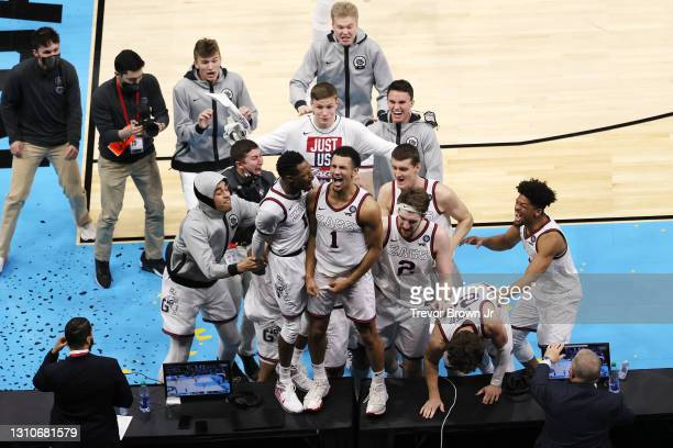 Jalen Suggs of the Gonzaga Bulldogs celebrates with teammates after making the game-winning, last-second, three-point shot in overtime against the...